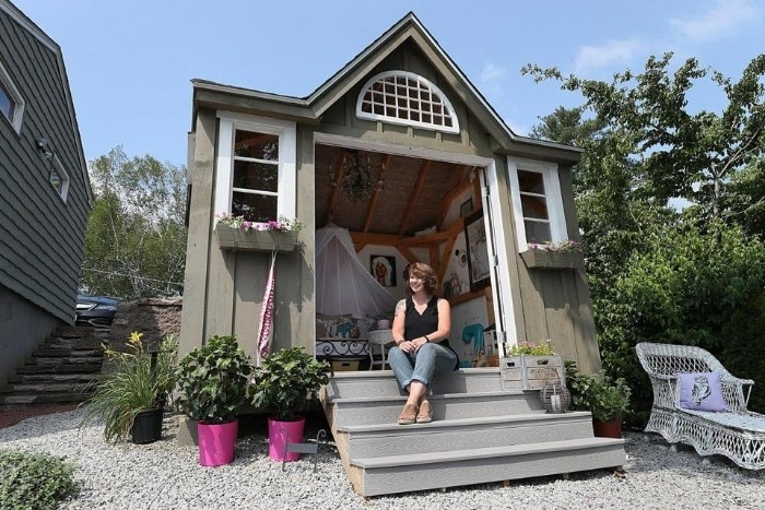 woman enjoying her she shed
