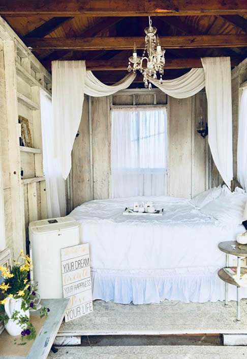Rustic chic shed bedroom